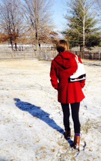 Photo by Jane M. Tucker. Ice skater in red coat