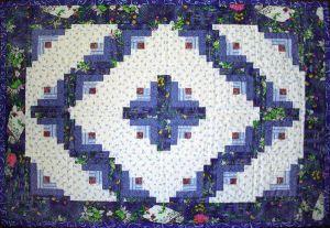 Log cabin quilt, from http://tatianaring.deviantart.com/