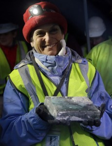Pamela Hatchfield, a conservator at the Boston's Museum of Fine Arts, holds a time capsule she removed from the cornerstone of the Statehouse in Boston, Thursday, Dec. 11, 2014. (AP Photo/Stephan Savoia)