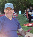 Jon at Jazz in the Woods. Note the hat and the shade.