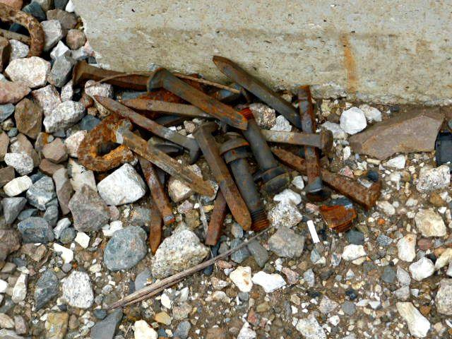 Rusty spikes beside Lenexa train tracks